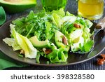 salad with avocado and pecans. | Shutterstock . vector #398328580