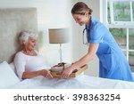 happy nurse giving food to