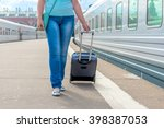 girl in jeans with a suitcase... | Shutterstock . vector #398387053