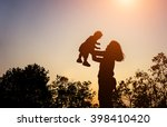 silhouette of mother with her... | Shutterstock . vector #398410420