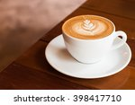 hot coffee latte with latte art | Shutterstock . vector #398417710