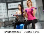 group of people exercising at... | Shutterstock . vector #398517148