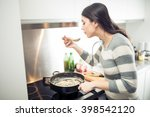 Woman Cooking Healthy Diet...