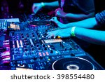 dj mixes the track in the... | Shutterstock . vector #398554480