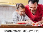 father and daughter making dough | Shutterstock . vector #398594644