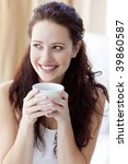 beautiful woman drinking a cup... | Shutterstock . vector #39860587