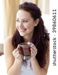 beautiful woman drinking a cup... | Shutterstock . vector #39860611