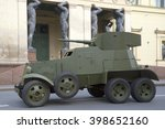 Small photo of ST. PETERSBURG, RUSSIA - MAY 05, 2015: Soviet cannon armored car 30-ies BA-3 on the background of the portico of the New Hermitage