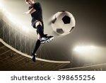 athlete kicking soccer ball in... | Shutterstock . vector #398655256