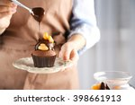 female baker decorating tasty... | Shutterstock . vector #398661913