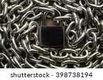 Small photo of check-lock and chain on wooden background concept