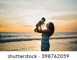 Young Woman With Her Baby On...