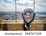 Small photo of Tourist binoculars at the top of the Empire State Building in New York City