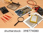 disassembled tablet and tools... | Shutterstock . vector #398774080
