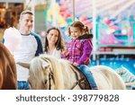 Girl Enjoying Pony Ride  Fun...