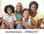 young family relaxing on sofa... | Shutterstock . vector #39882457