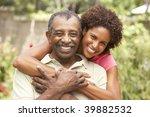 senior man hugging adult... | Shutterstock . vector #39882532