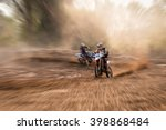 a motocross rider raises a... | Shutterstock . vector #398868484