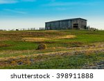 Tobacco Barn With Round Hay Bale
