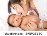 happy mother holding adorable... | Shutterstock . vector #398929180