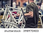 worker build a concert stage | Shutterstock . vector #398970403