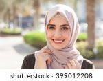 Smiling Girl In Hijab Covering...