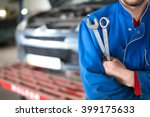 Hand Of Car Mechanic With...