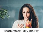 a pretty girl is licking her... | Shutterstock . vector #399186649