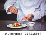 chef sprinkling spices on dish...   Shutterstock . vector #399216964