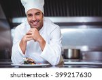 chef leaning on the counter... | Shutterstock . vector #399217630