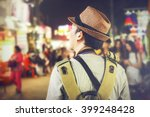 young male backpacker walking... | Shutterstock . vector #399248428