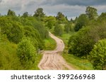 A Winding Country Road Going U...