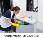 Female Housekeeper In White...