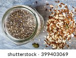 mixed seeds and a jar of chia... | Shutterstock . vector #399403069