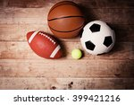 sports balls on wooden... | Shutterstock . vector #399421216