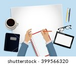 top view desk with hands on it | Shutterstock . vector #399566320