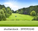 idyllic golf course with forest ...