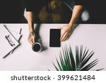 man with tattoo holding cup of... | Shutterstock . vector #399621484