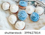 chocolate cupcakes on wooden... | Shutterstock . vector #399627814