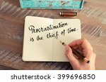 Stock photo retro effect and toned image of a woman hand writing on a notebook handwritten quote 399696850