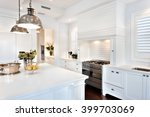Small photo of Beautiful kitchen having electrical automatic cooking gas and fruits, flowers kept on table
