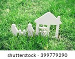 figures of house and family on... | Shutterstock . vector #399779290