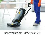 young janitor with washing... | Shutterstock . vector #399895198