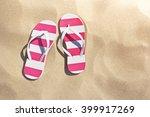 thongs on the beach   Shutterstock . vector #399917269