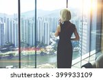 back view of young entrepreneur ... | Shutterstock . vector #399933109