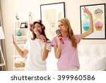 Two Girls Singing With Combs On ...
