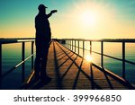 man on pier photograph morning... | Shutterstock . vector #399966850