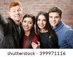 teenager friends making photo...   Shutterstock . vector #399971116