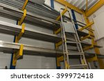 shelves with metal profiles in... | Shutterstock . vector #399972418