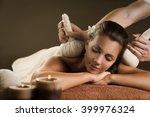 massage with herbal balls....   Shutterstock . vector #399976324